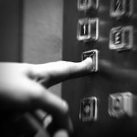 Finger Pushing Elevator Buttons
